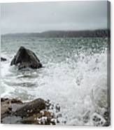 Ocean Water Crashing Againt Rocks With Cloudy Skies Canvas Print