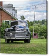 Old Car In Front Of House Canvas Print