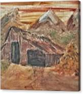 Old Farmhouse With Hay Stack In A Snow Capped Mountain Range With Tractor Tracks Gouged In The Soft  Canvas Print