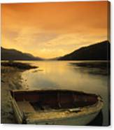 Old Rowboat At Waters Edge With Sunset Canvas Print