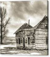Old Rustic Log House In The Snow Canvas Print