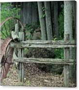 Old Rusty Wagon Wheels And Weathered Fence Canvas Print