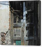 Old Wood Door In A Wall Canvas Print
