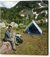 Older Man Resting In Backpacking Camp Canvas Print