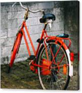 Orange Bicycle In The Street Canvas Print