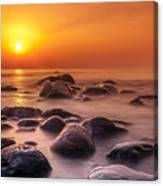 Orange Sunset Long Exposure Over Sea And Rocks Canvas Print