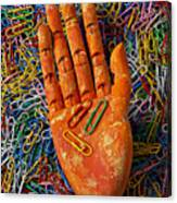 Orange Wooden Hand Holding Paperclips Canvas Print