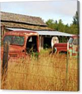 Out Of Gas. Rusty Trucks And Texaco Sign Canvas Print