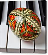 Painted Easter Egg On Piano Keys Canvas Print