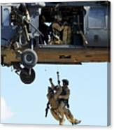 Pararescuemen Are Hoisted Into An Hh-60 Canvas Print