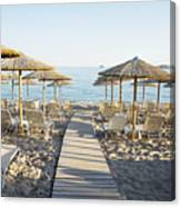 Parasol And Sunbeds At Sunset Canvas Print