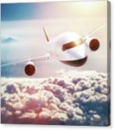 Passenger Airplane Flying At Sunset, Blue Sky. Canvas Print