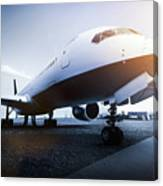 Passenger Airplane On The Airport Parking Canvas Print
