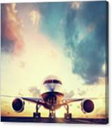 Passenger Airplane Taking Off On Runway At Sunset Canvas Print
