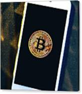 Phone With A Bitcoin Laying On Top Of It. Canvas Print