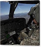 Pilot Operating The Cockpit Of A Uh-60 Canvas Print