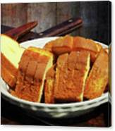 Plate With Sliced Bread And Knives Canvas Print