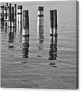 Poles In The Water Canvas Print