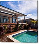 Poll And House With Deck Canvas Print