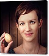 Pretty Young Brunette Woman Holding Hatching Egg Canvas Print