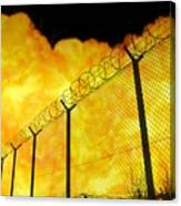 Realistic Orange Fire Explosion Behind Restricted Area Barbed Wire Fence, Blurred Background Canvas Print