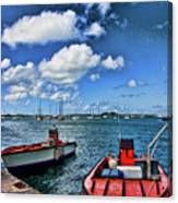 Red Boats At Blue Pier Canvas Print