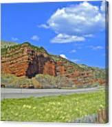 Red Cliffs And White Clouds Over Interstate 80 Rest Stop In Utah  Canvas Print