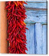 Red Peppers And Blue Door Canvas Print