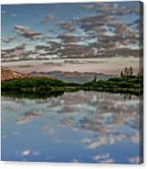 Reflection In A Mountain Pond Canvas Print