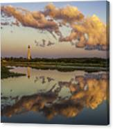 Reflection Of Clouds And Lighthouse Canvas Print