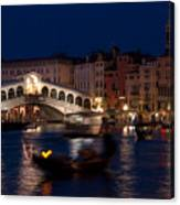 Rialto Bridge In Venice At Night With Gondola Canvas Print