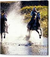 Riders In A Creek Canvas Print