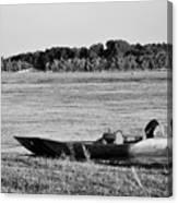 River Canoe Canvas Print
