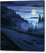 Road Near Foggy Forest In Mountains At Night Canvas Print