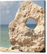Rock With A Hole With A Tropical Ocean In The Background. Canvas Print
