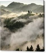 Rolling Fog At Sunrise In The Skofjelosko Hribovje Hills With St Canvas Print