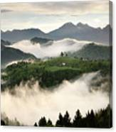 Rolling Fog At Sunrise With Mountains Of Kamnik Savinja Alps At  Canvas Print