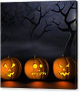 Row Of Halloween Pumpkins In A Spooky Forest At Night Canvas Print