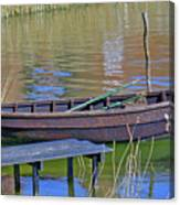 Rowboat And Blue Reflections Canvas Print