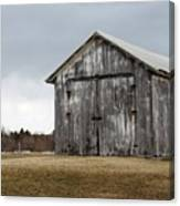 Rustic Barn With Dark Clouds Canvas Print