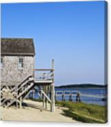 Rustic Boathouse On The Beach. Canvas Print