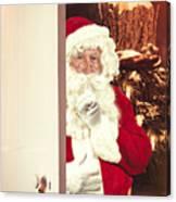 Santa Claus At Open Christmas Door Canvas Print