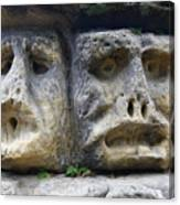 Scary Stone Heads Canvas Print