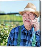 Senior Gardener Talking On The Phone With A Client. Canvas Print