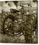 Sepia Toned Old Farmall Tractor In A Grassy Field Canvas Print