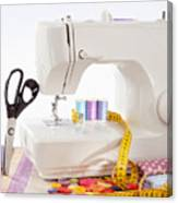 Sewing Machine With Many Sewing Utensils On A Wooden Box Canvas Print