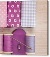 Sewing Threads Needle And Fabrics On A Wooden Box Canvas Print
