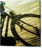 Shadow Of A Person Riding A Bicycle Canvas Print