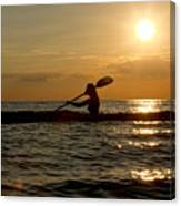 Silhouette Of Woman Kayaking In The Ocean. Canvas Print