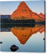 Sinopah Mountain Reflected In Two Medicine Lake At Sunrise Canvas Print
